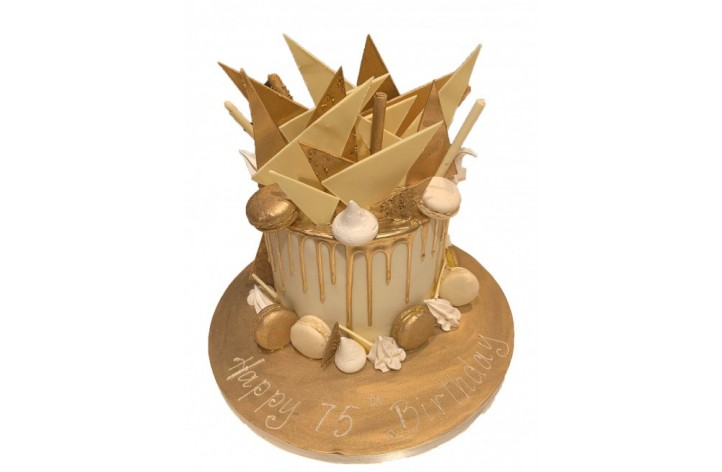 Golden Drip Cake with Chocolate Spikes