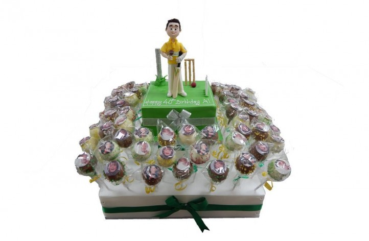 Cakepops and Cricket Scene Cake