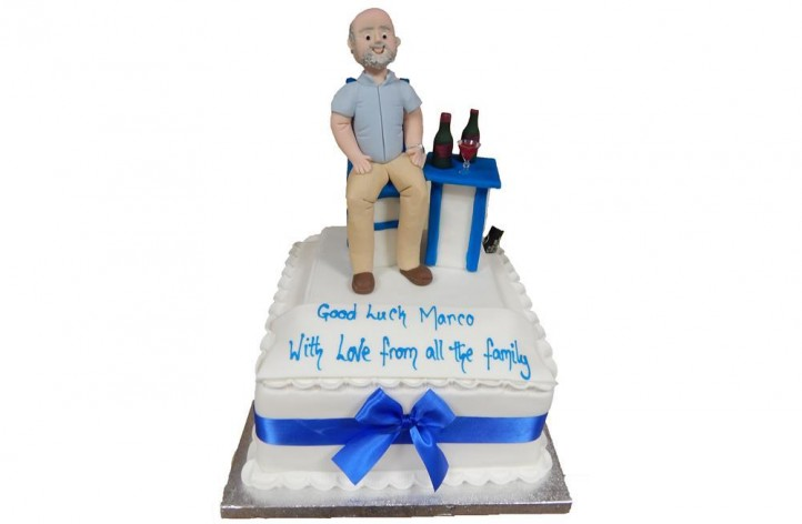 Figure at a Table Cake