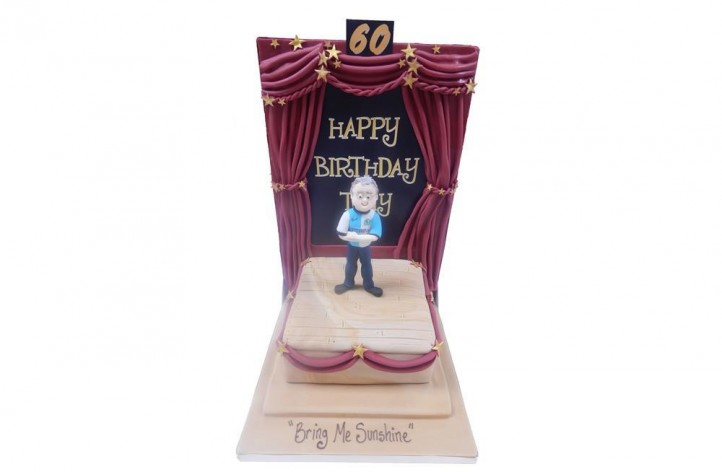 Figure on a Stage Cake